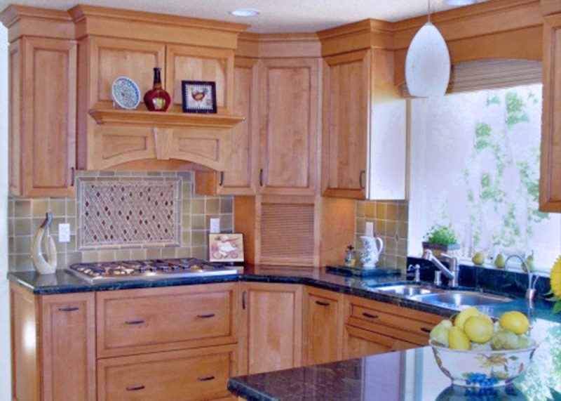 Maple wood cabinets in dark color & glaze, with custom hood as the focal point